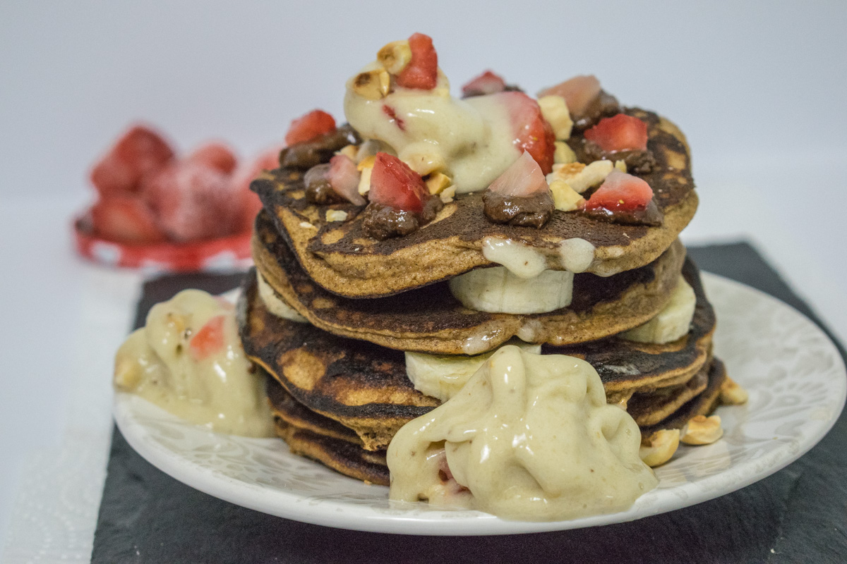 Healthy hazelnut butter pancakes with banana sauce