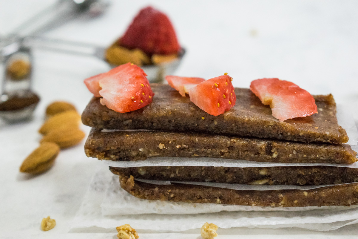 Raw date almond bars with strawberries and chocolate chunks